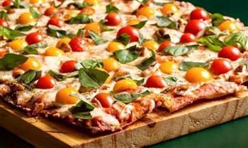 Pizza grande a elección + bebidas en Veggie Pizza