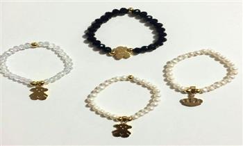 Lince: pulseras de perlas del río + dije en acero inoxidable.